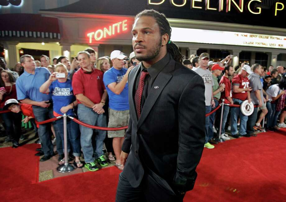 Georgia's Jarvis Jones arrives at the Home Depot College Football Awards in Lake Buena Vista, Fla., Thursday, Dec. 6, 2012. (AP Photo/John Raoux) Photo: John Raoux, Associated Press / AP