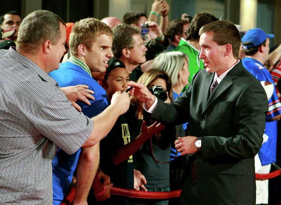 Florida kicker Caleb Sturgis, right, signs autographs for fans as he arrives at the Home Depot College Football Awards in Lake Buena Vista, Fla., Thursday, Dec. 6, 2012. (AP Photo/John Raoux) Photo: John Raoux, Associated Press / AP