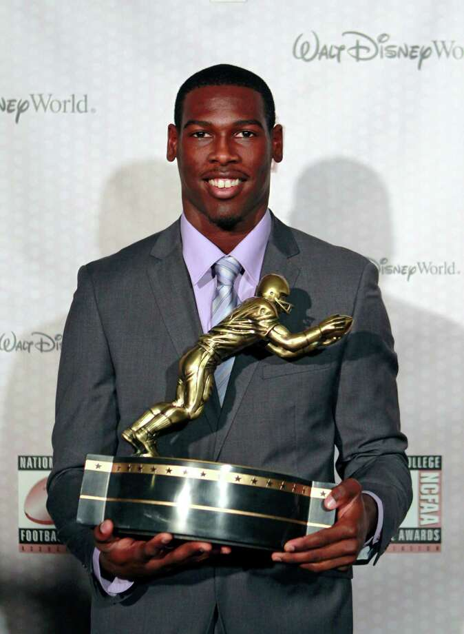 Southern California receiver Marqise Lee displays his trophy for the Biletnikoff Award after being named the nation's outstanding receiver at the Home Depot College Football Awards in Lake Buena Vista, Fla., Thursday, Dec. 6, 2012. (AP Photo/John Raoux) Photo: John Raoux, Associated Press / AP
