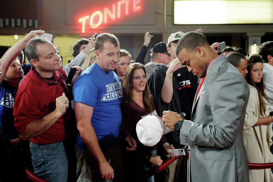 Alabama's Dee Milliner signs autographs for fans as he arrives at the Home Depot College Football Awards in Lake Buena Vista, Fla., Thursday, Dec. 6, 2012. (AP Photo/John Raoux) Photo: John Raoux, Associated Press / AP