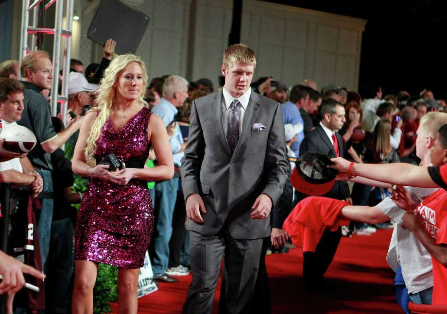 Kansas State quarterback Collin Klein, center right, and his wife Shalin arrive at the Home Depot College Football Awards in Lake Buena Vista, Fla., Thursday, Dec. 6, 2012.(AP Photo/John Raoux) Photo: John Raoux, Associated Press / AP