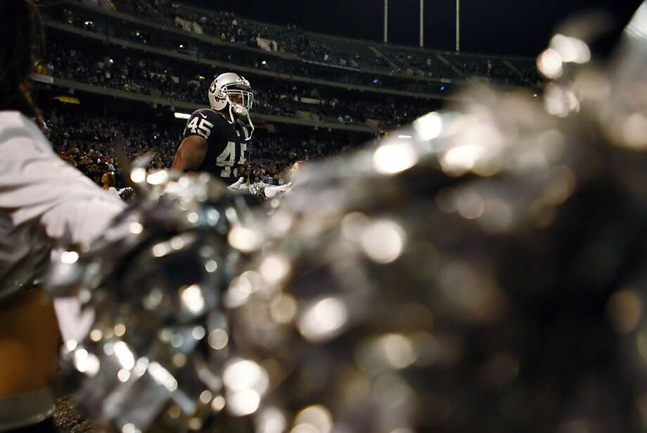 Marcel Reese enters the Coliseum during the Raiders's introductions on Thursday. The Oakland Raiders played the Denver Broncos at O.co Coliseum in Oakland, Calif., on Thursday, December 6, 2012. Photo: Carlos Avila Gonzalez, The Chronicle