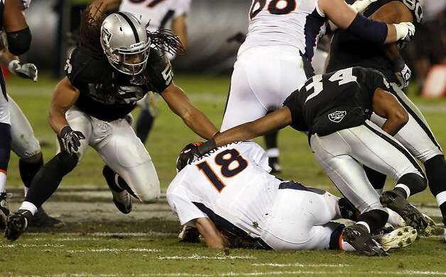 Mike Mitchell (34) sacks Peyton Manning in the second quarter. The Oakland Raiders played the Denver Broncos at O.co Coliseum in Oakland, Calif., on Thursday, December 6, 2012. Photo: Carlos Avila Gonzalez, The Chronicle