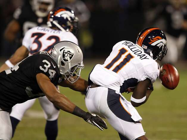 Trindon Holliday muffs a punt return in the first quarter as he is hit by Mike Mitchell, but the Broncos were able to recover the ball. The Oakland Raiders played the Denver Broncos at O.co Coliseum in Oakland, Calif., on Thursday, December 6, 2012. Photo: Carlos Avila Gonzalez, The Chronicle