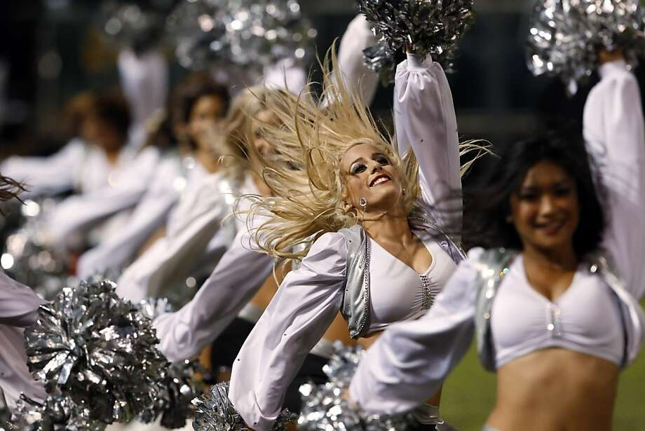 The Raiderettes perform during  a timeout in the fourth quarter of the Raiders game against the Broncos on Thursday. The Oakland Raiders played the Denver Broncos at O.co Coliseum in Oakland, Calif., on Thursday, December 6, 2012. Photo: Carlos Avila Gonzalez, The Chronicle