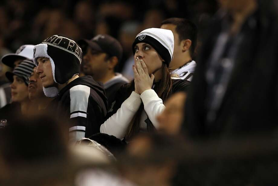 Raiders fans watch in the final minutes of the game against the Denver Broncos on Thursday.  The Oakland Raiders played the Denver Broncos at O.co Coliseum in Oakland, Calif., on Thursday, December 6, 2012. Photo: Carlos Avila Gonzalez, The Chronicle