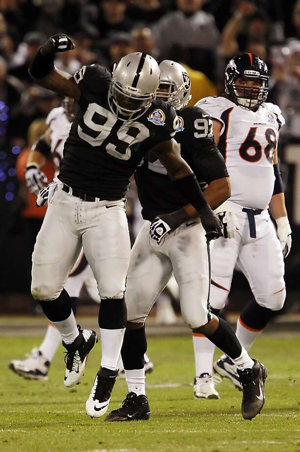 Lamarr Houston celebrates his first quarter sack of Peyton Manning. The Oakland Raiders played the Denver Broncos at O.co Coliseum in Oakland, Calif., on Thursday, December 6, 2012. Photo: Carlos Avila Gonzalez, The Chronicle