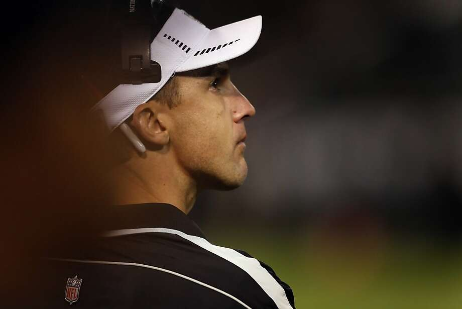 Dennis Allen, Raiders head coach, looks up at the game clock in the final minutes. The Oakland Raiders played the Denver Broncos at O.co Coliseum in Oakland, Calif., on Thursday, December 6, 2012. Photo: Carlos Avila Gonzalez, The Chronicle