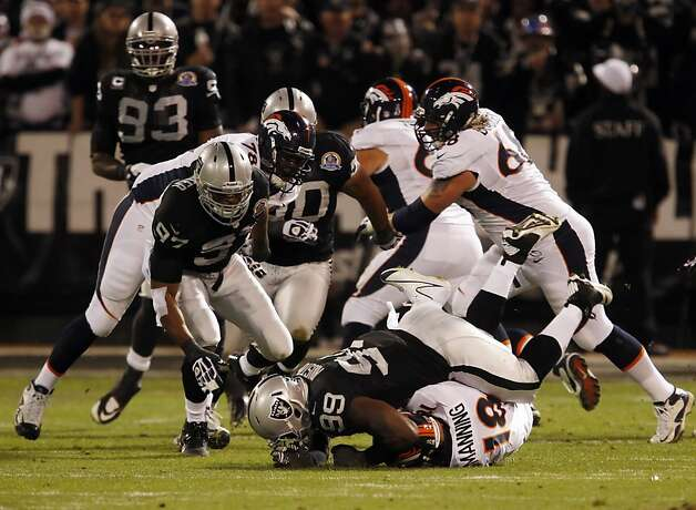 Lamarr Houston sacks Peyton Manning in the first quarter. The Oakland Raiders played the Denver Broncos at O.co Coliseum in Oakland, Calif., on Thursday, December 6, 2012. Photo: Carlos Avila Gonzalez, The Chronicle