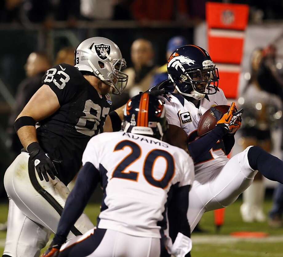 Champ Bailey intercepts a first quarter pass from Carson Palmer intended for Brandon Myers in the red zone. The Oakland Raiders played the Denver Broncos at O.co Coliseum in Oakland, Calif., on Thursday, December 6, 2012. Photo: Carlos Avila Gonzalez, The Chronicle