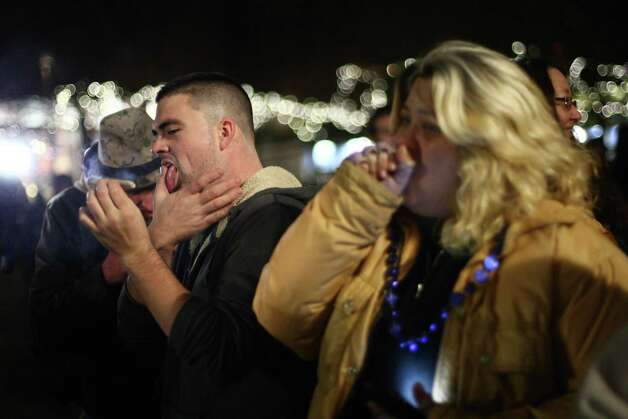 "People smoke pot on Thursday, December 6, 2012 during a ""stash mob"" at Seattle's International Fountain. Recreational use of marijuana was legalized by voters in Washington State and people have been celebrating by smoking publicly. Photo: JOSHUA TRUJILLO / SEATTLEPI.COM"