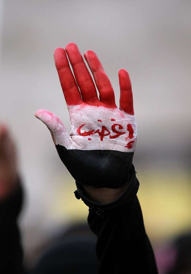 "A Yemeni protester with Arabic writing on his hands which read ""get angry"" takes part in a demonstration in Sanaa on December 6, 2012. Tens of thousands of demonstrators took part in a protest march in Sanaa against former Yemeni president Ali Abdullah Saleh whom critics accuse of holding out for a comeback. Photo: Mohammed Huwais, AFP/Getty Images"