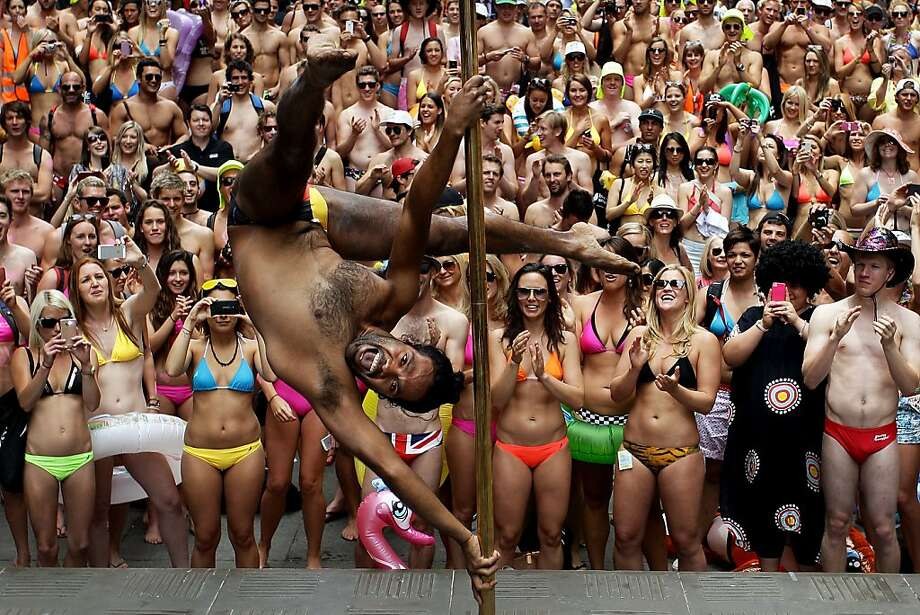 Dancer Matty Shields entertains the crowd prior to the 'AIME Strut the Streets' attempt to break the Guiness record for the world's largest swimwear parade on December 7, 2012 in Sydney, Australia. The event was organised to raise funds and awareness for the not for profit charity organisation, the Australian Indigenous Mentoring Experience. Photo: Lisa Maree Williams, Getty Images