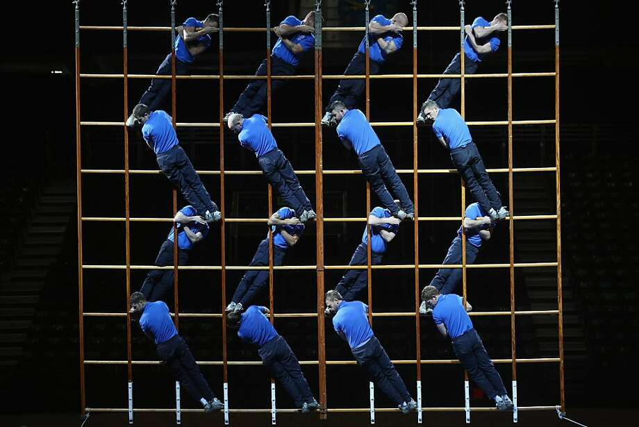 Members of the Royal Navy Window Ladder Display Team practice their routine in Earls Court exhibition centre on December 6, 2012 in London, England. The team will participate in the 2012 British Military Tournament which takes place in Earls Court on December 8-9, 2012. The tournament features over 600 servicemen and women and 160 horses it showcases military skills to raise funds for the armed forces. Photo: Oli Scarff, Getty Images