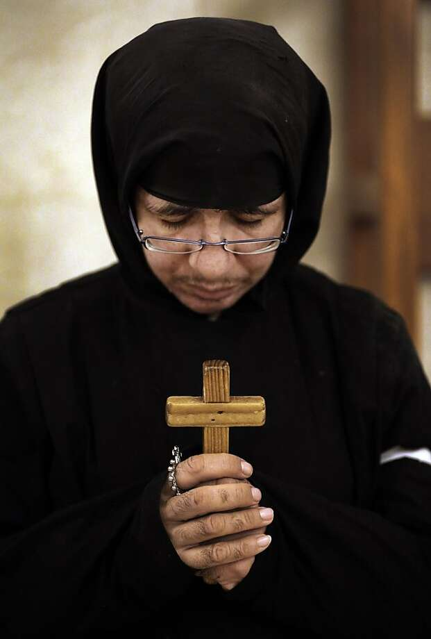 A member of the clergy prays during a mass service for the Patriarch of Antioch and the East, Ignatius Hazim IV, not pictured, at the Saint Nicolas Church in Beirut, Lebanon, Thursday Dec. 6, 2012. The patriarch of a Damascus-based Eastern Orthodox Church, Ignatius Hazim, has died in a Beirut hospital. He was 92. Hazim's funeral procession will be held in Beirut on Sunday, then his remains will be taken from Lebanon to Syria for burial. Photo: Hussein Malla, Associated Press