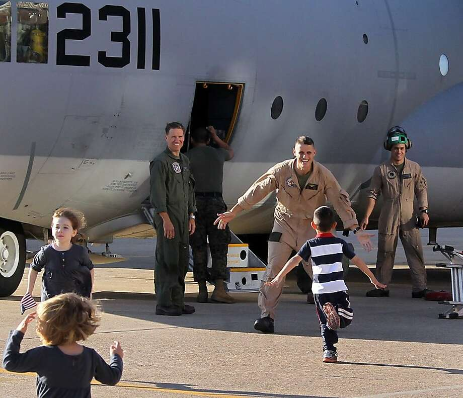 Children sprint towards the C-130 to meet their dads as members of the US Marines return from their overseas deployment at he Naval Air Station Joint Reserve Base Fort Worth, Texas on Thursday, Dec. 6, 2012. The group of 29 members of Marine squadron VMGR 234 were returning from their Mideast Deployment. Photo: Louis DeLuca, Associated Press