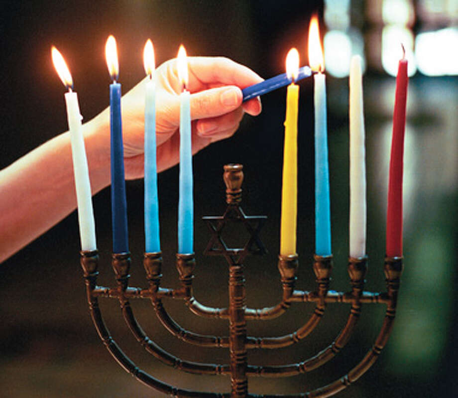 Jewish families around the world beginning at sundown Saturday will light menorahs to celebrate Hanukkah, the eight-day festival of light. Photo: File Photo