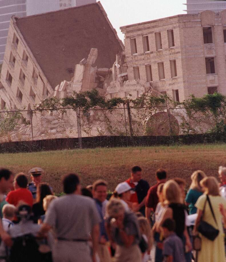Spectators view what is left of the Jeff Davis Hospital Building administration building after its implosion Saturday morning, May 15, 1999. (Smiley N. Pool / Houston Chronicle)