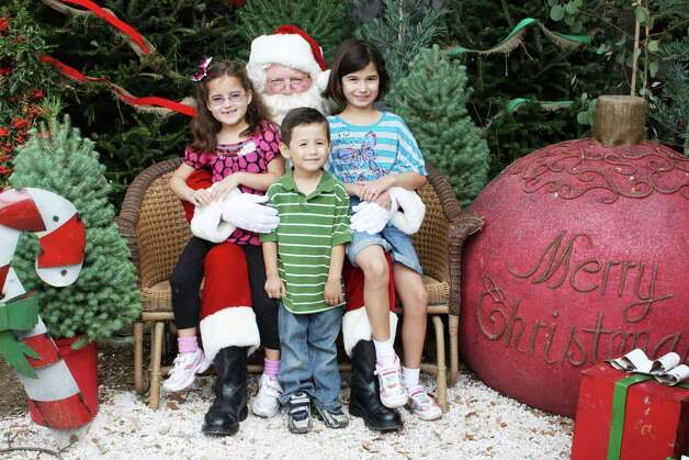 Santa Photos – Saturday, December 1, 2012 Milberger Landscaping and Nursery Photo: Express-News / SA Photo: Santa Photos – Saturday, December 1, 2012 Milberger Landscaping And Nursery Photo: Express-News / SA