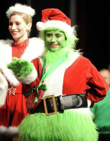 The Nederland Whimsical Christmas Production will take place at the Performing Arts Center at Nederland High School on Friday at 7 P.M. and Sunday at 2 P.M.  The Saturday production had to be moved to Sunday because  the Nederland football team will be playing in Cypress on Saturday, December 8, 2012 against Georgetown at 3 P.M.  The conflict came because a good amount of the performers in the production are involved with the football team such as varsity cheerleader Bethany Cherry, left, and junior varsity cheerleader Lauren Konjayan, right, as seen in practice on Tuesday, December 5, 2012. Photo taken: Randy Edwards/The Enterprise Photo: Randy Edwards