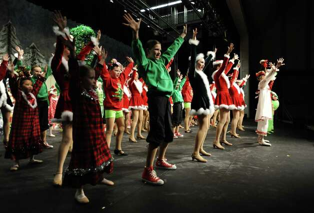 The Nederland Whimsical Christmas Production will take place at the Performing Arts Center at Nederland High School on Friday at 7 P.M. and Sunday at 2 P.M.  The Saturday production had to be moved to Sunday because  the Nederland football team will be playing in Cypress on Saturday, December 8, 2012 against Georgetown at 3 P.M.  The conflict came because a good amount of the performers in the production are involved with the football team as seen in practice on Tuesday, December 5, 2012. Photo taken: Randy Edwards/The Enterprise