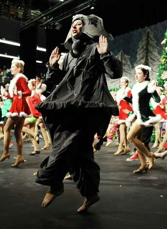 The Nederland Whimsical Christmas Production will take place at the Performing Arts Center at Nederland High School on Friday at 7 P.M. and Sunday at 2 P.M.  The Saturday production had to be moved to Sunday because  the Nederland football team will be playing in Cypress on Saturday, December 8, 2012 against Georgetown at 3 P.M.  The conflict came because a good amount of the performers in the production are involved with the football team as seen in practice on Tuesday, December 5, 2012. Photo taken: Randy Edwards/The Enterprise Photo: Randy Edwards