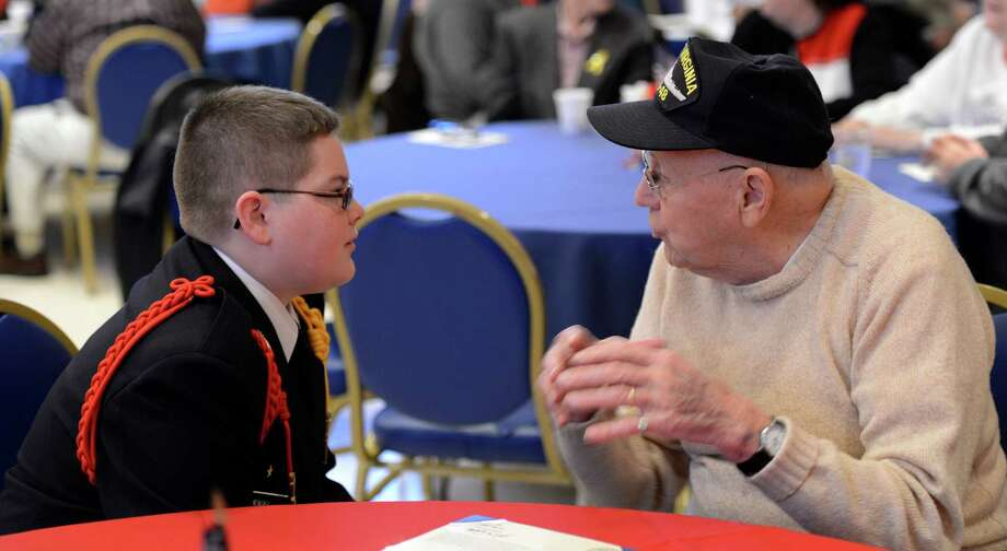 Pearl Harbor survivor A.J. Krenn, right, speaks with 14-year-old Christian Brothers Academy freshman Ethan Mendel at the Pearl Harbor Day Memorial Observance at the J.E. Zaloga Post in Albany, N.Y., on Dec. 7, 2012. It is the 71st anniversary of the bombing of Pearl Harbor.  (Skip Dickstein/Times Union) Photo: SKIP DICKSTEIN / 00020374A