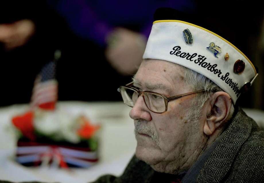 Pearl Harbor survivor Charles Ebel listens to speeches at the Pearl Harbor Day Memorial Observance held annually at the J.E. Zaloga Post in Albany, N.Y. Dec 7, 2012 the 71st anniversary of the bombing of Pearl Harbor.  (Skip Dickstein/Times Union) Photo: SKIP DICKSTEIN / 00020374A