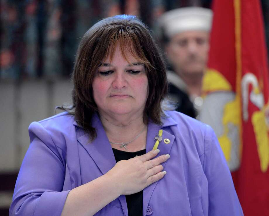 Rev. Charlene Robbins who is a gold star mother listens as the Navy Hymn is played at the Pearl Harbor Day Memorial Observance held annually at the J.E. Zaloga Post in Albany, N.Y. Dec 7, 2012 the 71st anniversary of the bombing of Pearl Harbor.  (Skip Dickstein/Times Union) Photo: SKIP DICKSTEIN / 00020374A