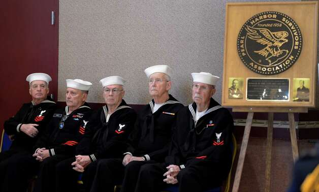 Members of the color guard take a moment to themselves at the Pearl Harbor Day Memorial Observance at the J.E. Zaloga Post in Albany, N.Y., on Dec. 7, 2012. It is the 71st anniversary of the bombing of Pearl Harbor.  (Skip Dickstein/Times Union) Photo: SKIP DICKSTEIN / 00020374A