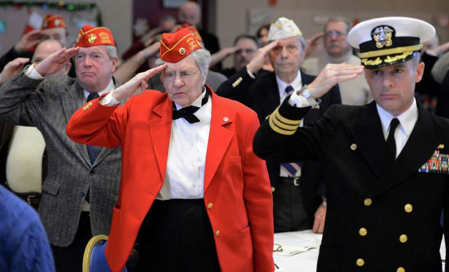 Former and present members of the military salute the colors at the Pearl Harbor Day Memorial Observance held annually at the J.E. Zaloga Post in Albany, N.Y. Dec 7, 2012 the 71st anniversary of the bombing of Pearl Harbor.  (Skip Dickstein/Times Union) Photo: SKIP DICKSTEIN / 00020374A