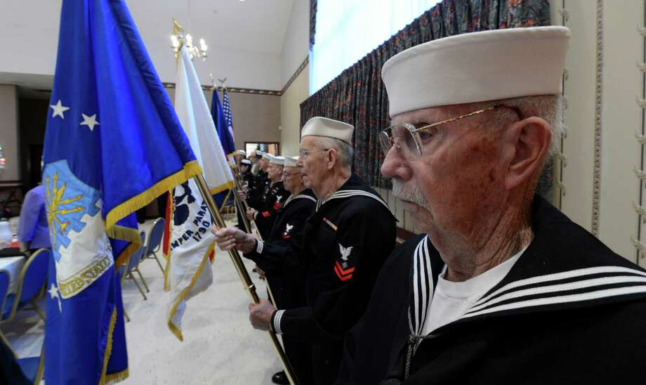 Color Guard member Bill Haggart, presents colors at the Pearl Harbor Day Memorial Observance held annually at the J.E. Zaloga Post in Albany, N.Y. Dec 7, 2012 the 71st anniversary of the bombing of Pearl Harbor.  (Skip Dickstein/Times Union) Photo: SKIP DICKSTEIN / 00020374A