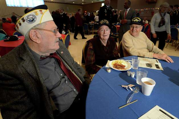 Three Pearl Harbor survivors in attendance are, from left to right, Charles Ebel, Bill Langston and A.J. Krenn at the J.E. Zaloga Post in Albany, N.Y., on Dec. 7, 2012. It is the 71st anniversary of the bombing of Pearl Harbor.  (Skip Dickstein/Times Union) Photo: SKIP DICKSTEIN / 00020374A
