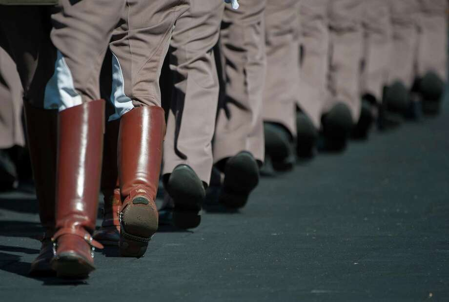 THE CORPS OF CADETS:A member of the Corps only gets to wear boots as a senior. Photo: Dave Einsel, Associated Press / FR43584 AP