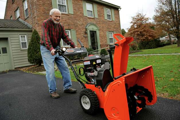 Joe Faul brings out his snowblower on Wednesday, Nov. 28, 2012, at his home in Albany, N.Y. (Cindy Schultz / Times Union) Photo: Cindy Schultz / 00020284A