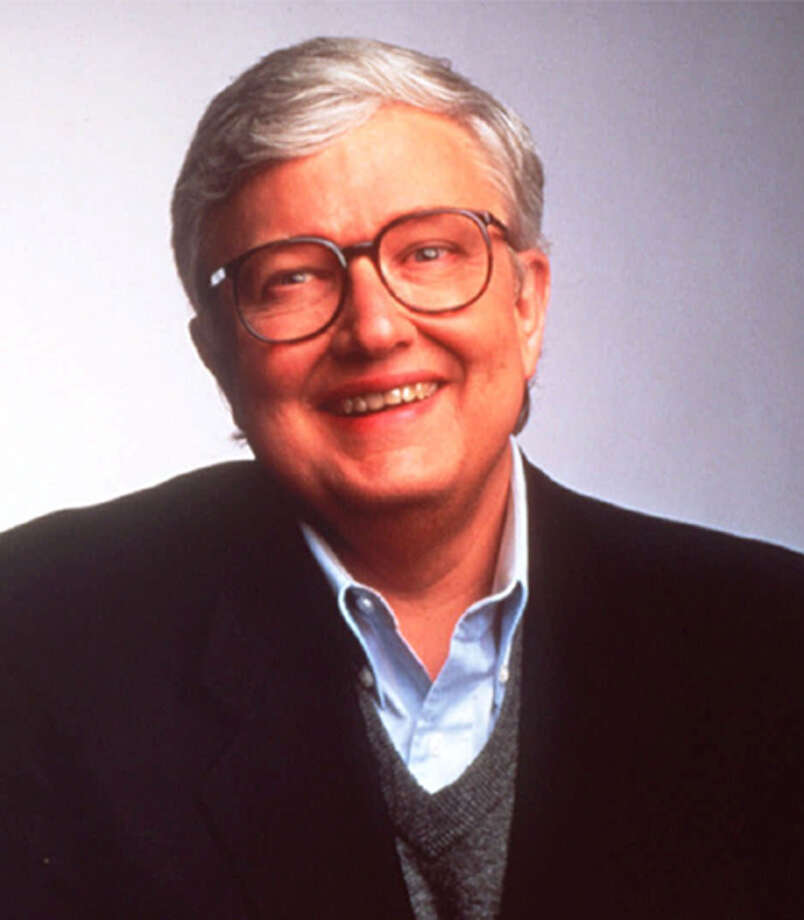 ** FILE ** Film critic Roger Ebert is seen in this 1994 file photo. Ebert, in town for his annual Overlooked Film Festival, slipped on a newly waxed floor and suffered two hairline fractures in his left shoulder Saturday, April 27, 2002, in the student union at the University of Illinois. Photo: AP / BUENA VISTA TELEVISION