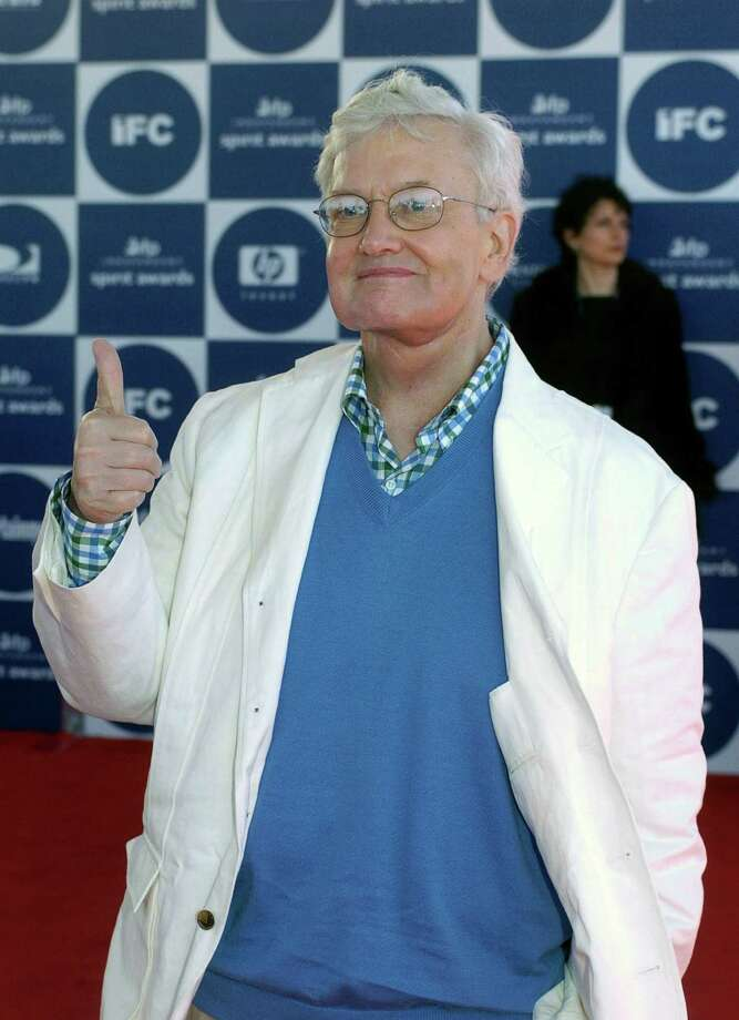 "Film critic Roger Ebert gives thumbs up as he arrives for the 2004 IFP Independent Spirit Awards in Santa Monica, Calif., in a Saturday, Feb. 28, 2004 file photo. Roger Ebert has turned thumbs down on thumbs on ""At the Movies with Ebert & Roeper."" Ebert, who is negotiating a new contract with the syndicated show's distributor, Disney-ABC Domestic Television, is a copyright holder on the show's signature ""thumbs up-thumbs down"" judgment that's part of each film review. Photo: CHRIS PIZZELLO, AP / AP"
