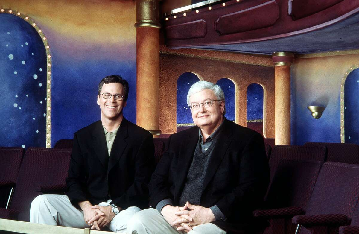 Film critics Roger Roeper, left, and Roger Ebert pose in the balcony set for their syndicated show,