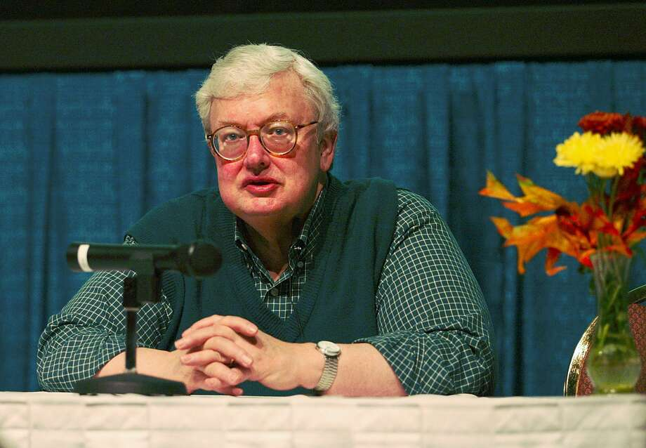 Film critic Roger Ebert speaks at the 15th Annual Virginia Film Festival, in this Oct. 26, 2002 file photo, in Charlottesville, Va. Ebert, the Pulitzer Prize winning film critic, will undergo radiation treatment for cancer next month. The treatment will be for a cancerous tumor in Ebert's salivary gland, the Chicago Sun-Times reported, Wednesday, Aug. 6, 2003. Photo: ANDREW SHURTLEFF, AP / THE DAILY PROGRESS