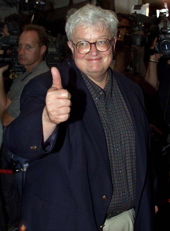 "Movie critic Roger Ebert gives the thumbs up as he arrives on the red carpet for the premiere of the film ""Training Day"" at the Toronto International Film Festival in Toronto, Canada, in this Sept. 7, 2001. Ebert will undergo surgery to remove a cancerous growth on his thyroid gland. The operation for Ebert, a Chicago Sun-Times movie reviewer, is scheduled for Friday, the paper reported Thursday, Feb. 21, 2002. Photo: KEVIN FRAYER, AP / CP"