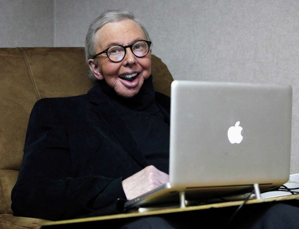 FILE - In this photo taken Wednesday, Jan. 12, 2011, Pulitzer Prize-winning movie critic Roger Ebert works in his office at the WTTW-TV studios in Chicago. The Sundance Institute announced Thursday, Sept. 20, 2012 that Ebert will be the recipient of the Vanguard Leadership Award in recognition of his advocacy of independent film. The award will be presented at the third annual