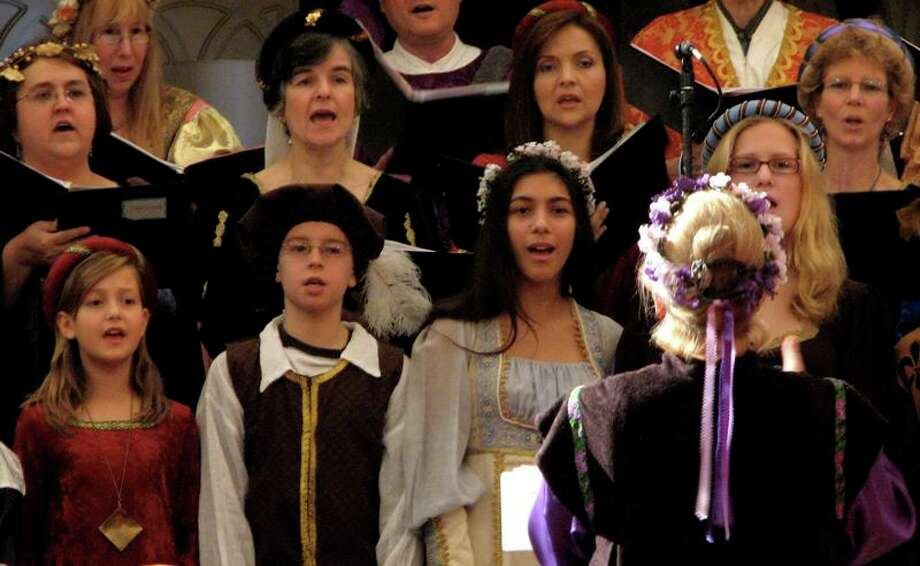 Singers if medieval dress perform in the First Unitarian Society of Schenectady's Yuletide Revels to be held Friday, Dec. 12, 7:30 p.m. and Sunday, Dec. 14, 10:30 a.m