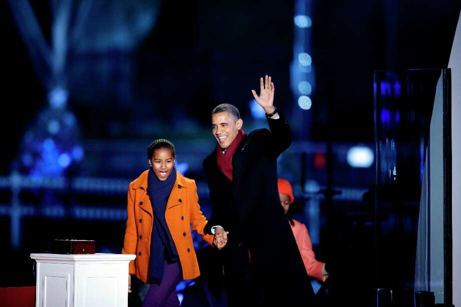 President Barack Obama, arrives with daughter Sasha Obama for the 90th annual National Christmas Tree Lighting ceremony on the Ellipse south of the White House, Thursday, Dec. 6, 2012 in Washington. (Alex Brandon / AP Photo) Photo: Alex Brandon, Associated Press / AP