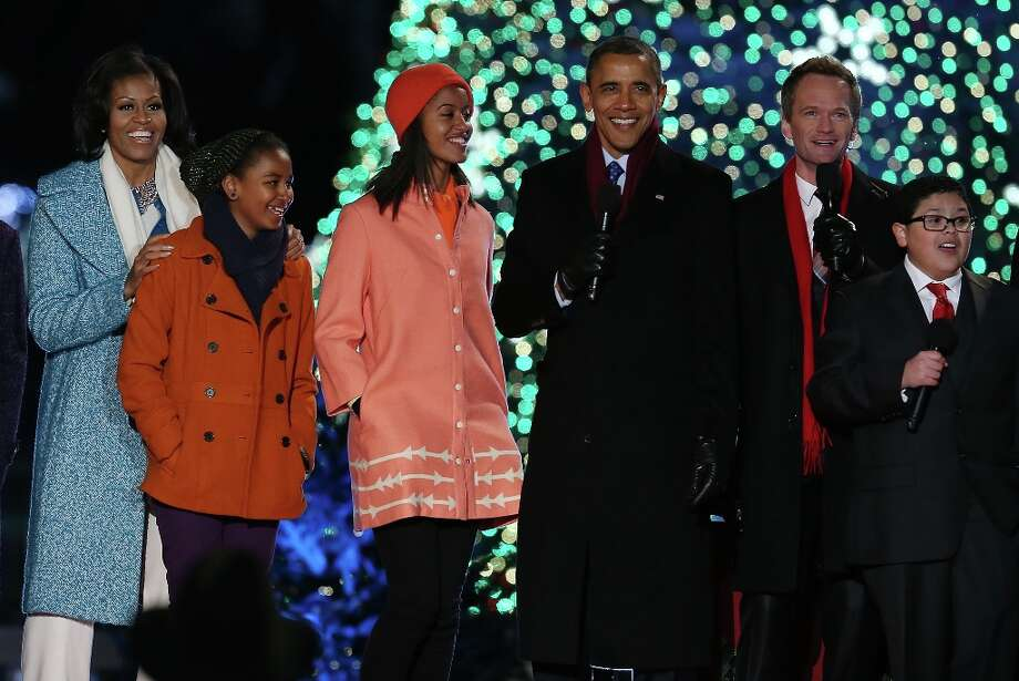 U.S. President Barack Obama, sings a Christmas song with his daughters Malia (3rd-L) and Sasha (2nd-L), first lady Michelle Obama (L), Actor Neil Patrick Harris (2nd-R), and Rico Rodriguez (R),during the annual lighting of the National Christmas tree on December 6, 2012 in Washington, DC. This year is the 90th annual National Christmas Tree Lighting Ceremony. Photo: Mark Wilson, Getty Images / 2012 Getty Images
