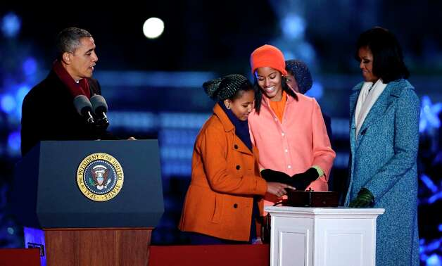 President Barack Obama, first lady Michelle Obama, Sasha Obama, Malia Obama, participate in the 90th annual National Christmas Tree Lighting ceremony on the Ellipse south of the White House, Thursday, Dec. 6, 2012 in Washington. (Alex Brandon / AP Photo) Photo: Alex Brandon, Associated Press / AP