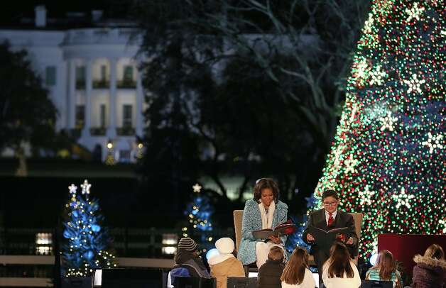 First lady Michelle Obama (L), and actor Rico Rodriguez (R), reads Christmas books to children during the annual lighting of the National Christmas tree on December 6, 2012 in Washington, DC. This year is the 90th annual National Christmas Tree Lighting Ceremony. Photo: Mark Wilson, Getty Images / 2012 Getty Images