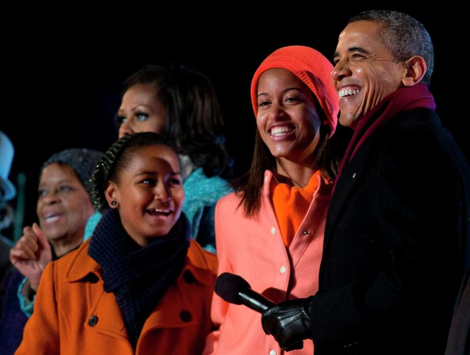 President Barack Obama, first lady Michelle Obama and their daughters Sasha and Malia, and mother-in-law Marian Robinson, sing during the annual National Christmas Tree Lighting on the Ellipse, Thursday, Dec. 6, 2012, in Washington. This year's giant blue spruce is new, transplanted in October on the Ellipse, south of the White House. (Carolyn Kaster / AP Photo) Photo: Carolyn Kaster, Associated Press / AP