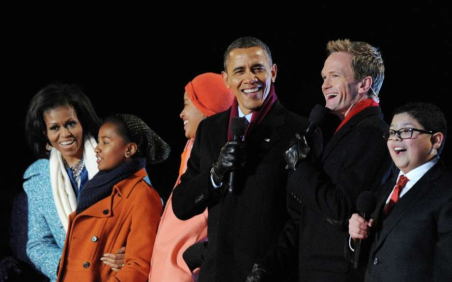 U.S. President Barack Obama (C) with his wife first lady Michelle Obama (L) and their daughters Malia and Sasha Obama (2nd L), sing on stage with actor Neil Patrick Harris (3rd R), Rico Rodriguez (2nd R) , actor on Modern Family during the 90th National Christmas Tree Lighting Ceremony on the Ellipse behind the White House on December 6, 2012 in Washington, DC. This year is the 90th annual National Christmas Tree Lighting Ceremony. Photo: Pool, Getty Images / 2012 Getty Images