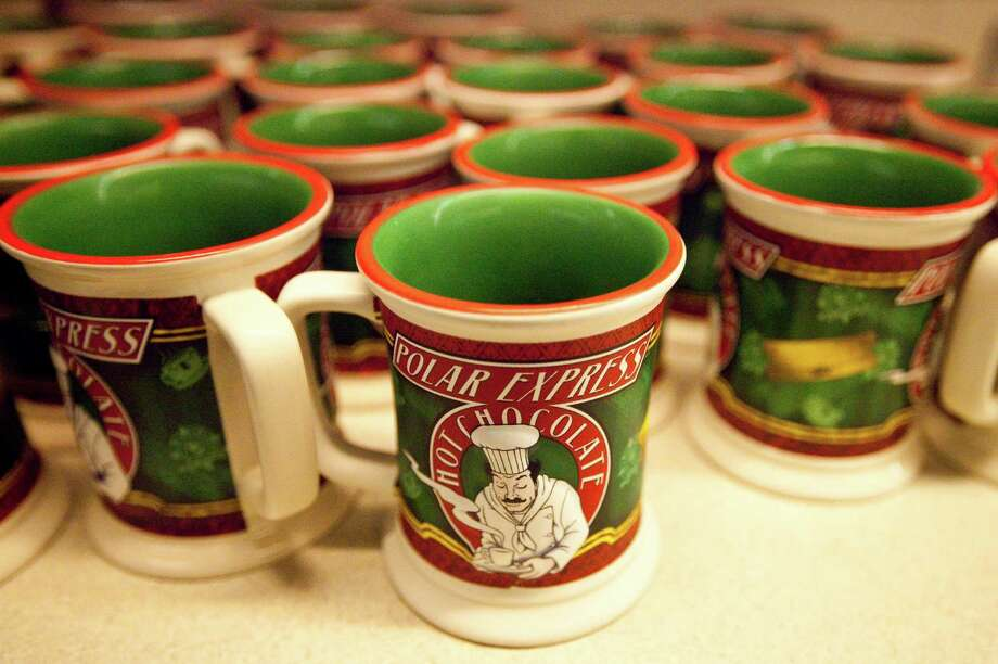 Mugs of hot chocolate are lined up for quick distribution to Polar Express travelers. Photo: Nick De La Torre, Staff / © 2012  Houston Chronicle