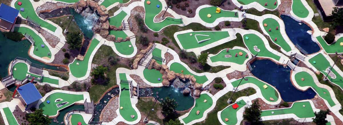 The greens of The Ice & Golf Center at Northwoods are seen in this April 10, 2012 aerial photo. Two 18-hole courses with 5 ponds, two waterfalls, and several water hazards grace the facility in the southeast corner of the U.S. 281 and Loop 1604 intersection.